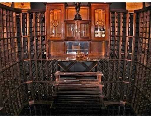 Formal spaces plus a stunning mahogany library.