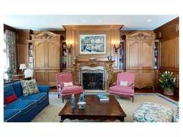This room featuresbuilt-in bookshelves and furniture armoires.