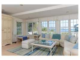 This elegant seaside Cape is set on 1.5+ private acres.