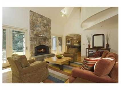 The great room features a stone fireplace.