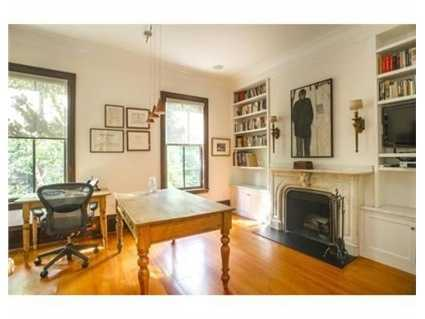 The home features pumpkin pine floors.