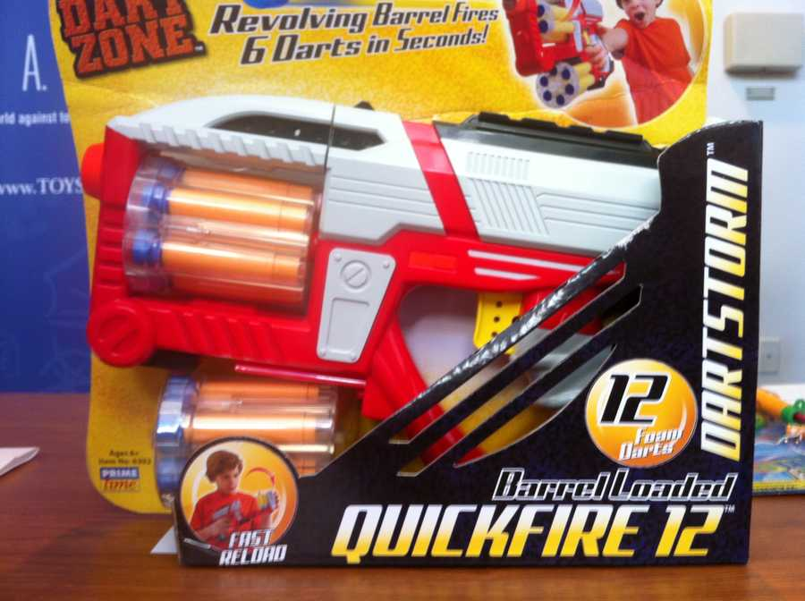 "Dart Zone Quickfire 12 Dart GunW.A.T.C.H. warns there is potential for eye injuries. The manufacturer of this dart gun with two ""revolving barrels"" encourages children to load the ammunition cartridge and fire ""6 darts in seconds!"" Despite the manufacturer's directive that this toy not be sold for children younger than 6 years old, it was marketed online for babies as young as 7 months old. The gun can shoot the supplied darts with enough force to potentially cause eye injuries."