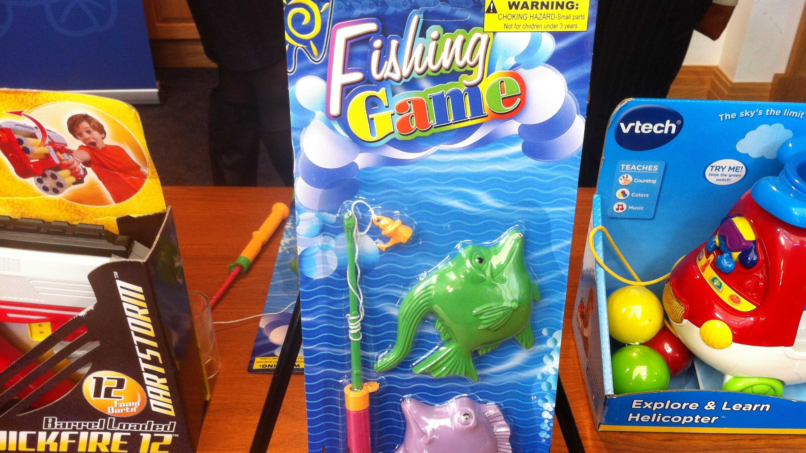 "Magnetic Fishing Game by Kole Imports. POTENTIAL FOR CHOKING INJURIES! According to W.A.T.C.H., this ""fishing game"" is sold online for 16-month-old children, however, the packaging contains a warning of a choking hazard for children under 3 years old. The plastic fishing pole uses common twine to attach a small, magnetic lure. The brightly-colored plastic lure, whether detached or connected to the approximately 9""-long cord, poses a serious potential choking hazard for oral-age children."