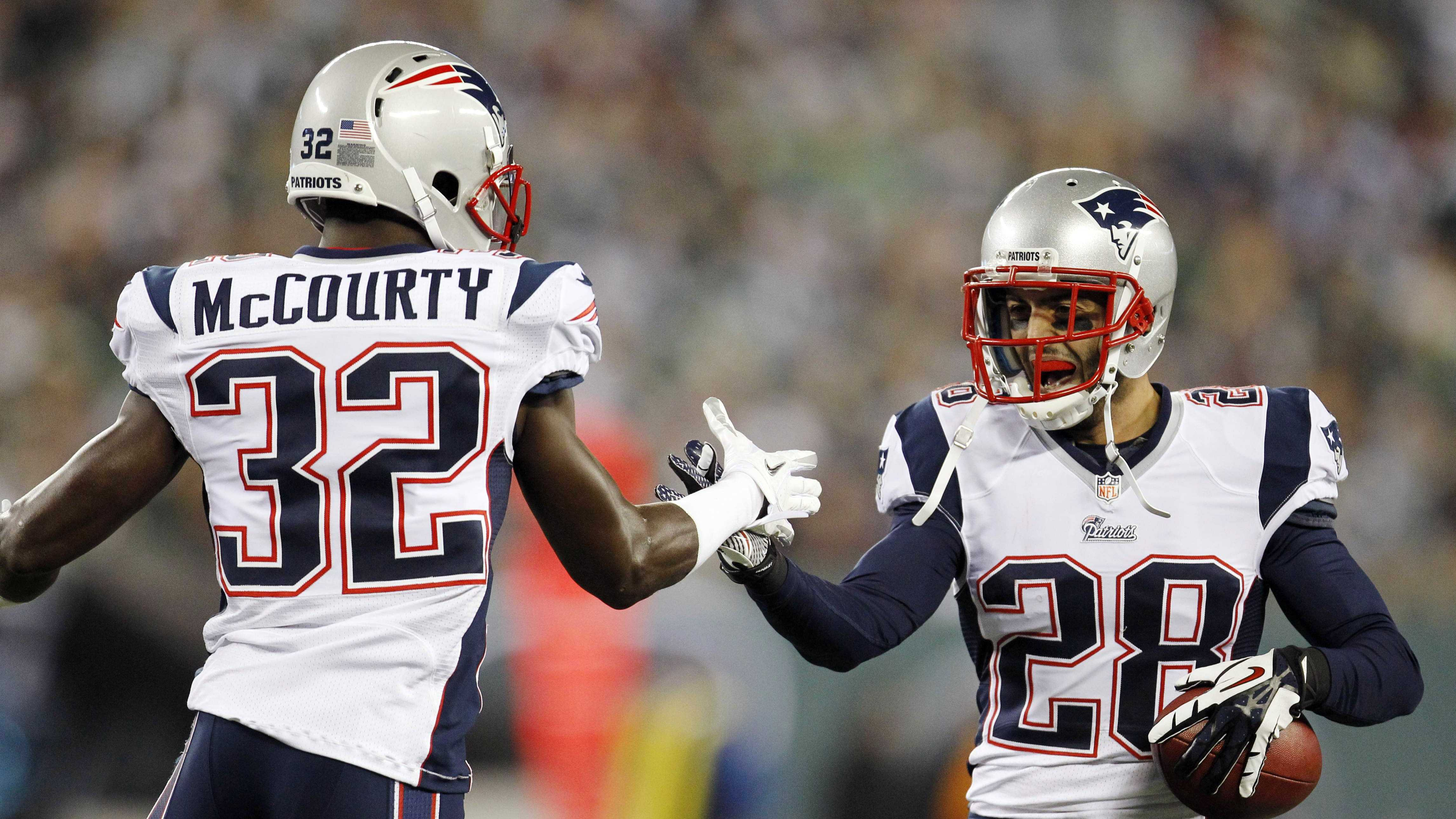 New England Patriots strong safety Steve Gregory (28) celebrates with teammates after returning a fumble for a touchdown.