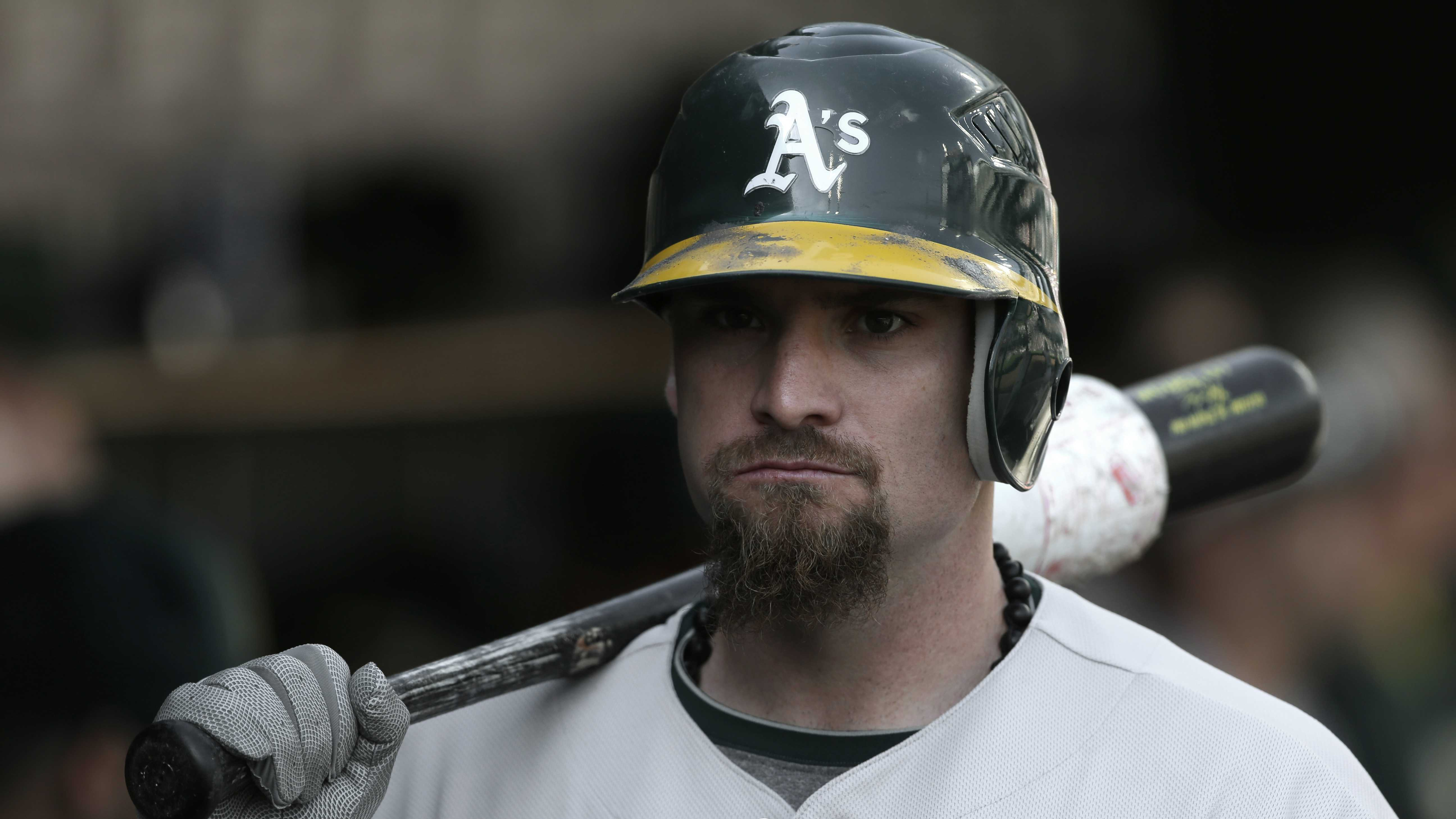 Oakland Athletics' Jonny Gomes waits to bat against the Detroit Tigers in the ninth inning of a baseball game in Detroit, Thursday, Sept. 20, 2012.
