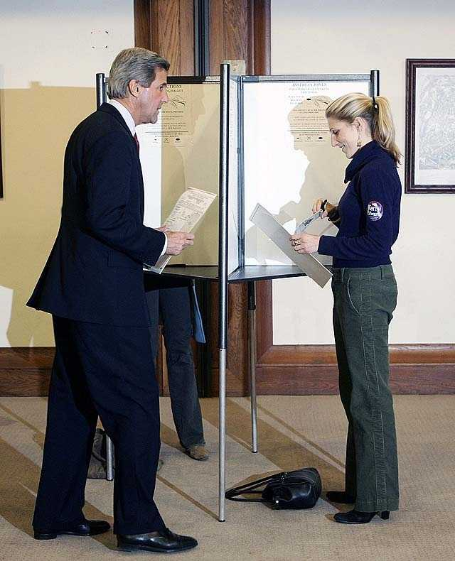 Democratic Presidential candidate Sen. John Kerry, D-Mass., walks to the ballot box as he votes at the Statehouse on Election Day in Boston, Tuesday, Nov. 2, 2004. Voting at right is his daughter Vanessa Kerry.