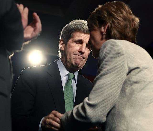 U.S. Senator John Kerry, D-Mass., center, reacts as Democrat candidate, Massachusetts Attorney General Martha Coakley, right, concedes after losing a special election in Boston, Tuesday, Jan. 19, 2010, held to fill the U.S. Senate seat left vacant by the death of Sen. Edward Kennedy.