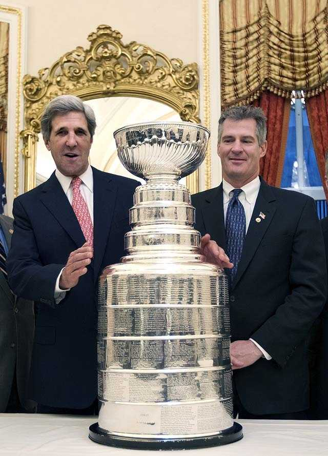 Sen. John Kerry, D-Mass., left, and Sen. Scott Brown, R-Mass., right, pose with the Stanley Cup during a breakfast celebration in honor of the Boston Bruins, in Washington, Feb. 29, 2012.