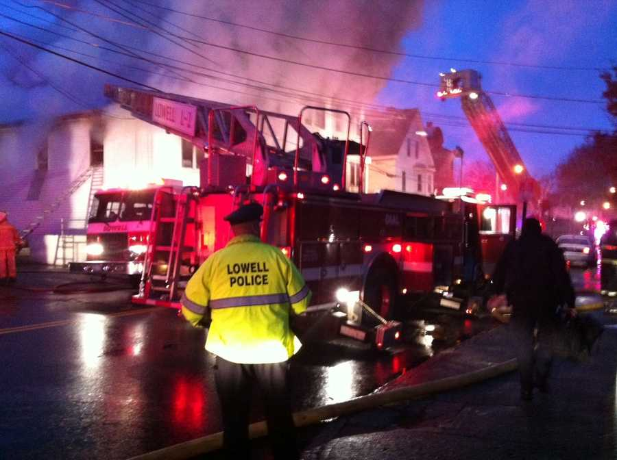 Lowell firefighters are battling a four-alarm fire.