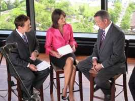 Ed Harding and Liz Brunner tape a promotional spot with then-ABC News anchor Charles Gibson.