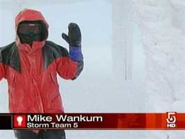 Meteorologist Mike Wankum covering a storm in 2011