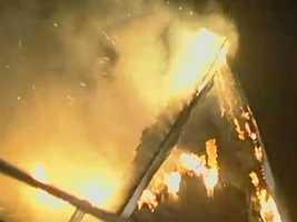 A three-alarm fire tore through the Cape Cod Bible Alliance Church in Brewster overnight.