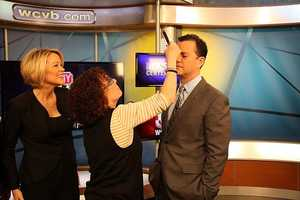 Heather Unruh looks on as Kimmel gets makeup