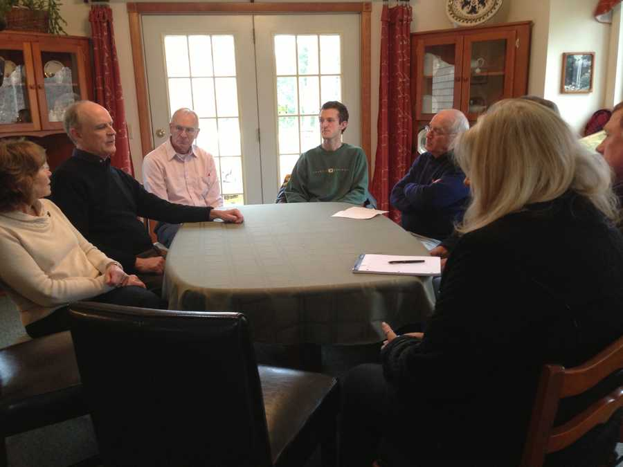 Members of the church in Brewster meeting at the pastor's home. They were planning how to get through Christmas and to rebuild.
