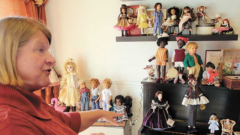 Rosemary Laverdiere, of Leominster, shows off some of the many dolls in her collection. She's president of Yankee Doodle Dollers.