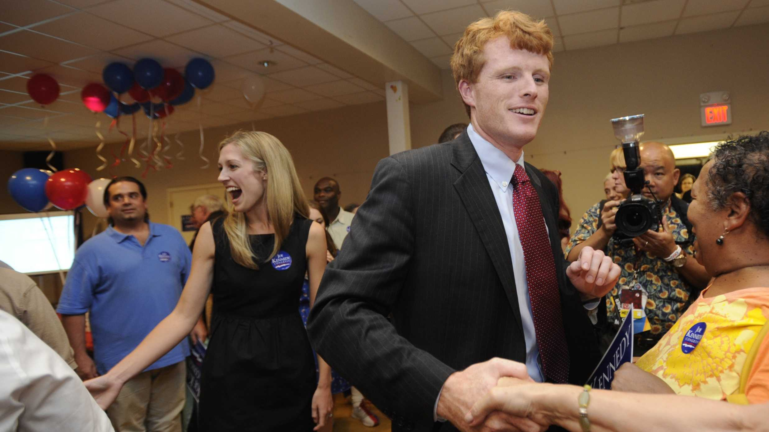 Joseph Kennedy III and his fiance Lauren Anne Birchfield, left, greet supporters during a party in Taunton, Mass., Thursday, Sept. 6, 2012.