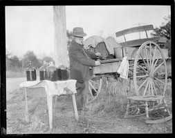 A man operates a still out of the back of a carriage
