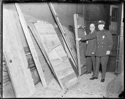 Police tear down speakeasy's doors and bring them to the police stations in their sections in 1930
