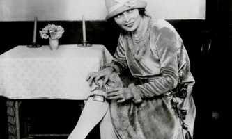 A woman shows off the flask hidden in her garter, 1926