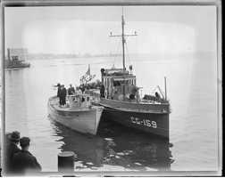 A rum runner is brought in for appraisal in 1931