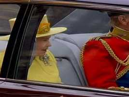 They arrived by limousine. The queen wore yellow.