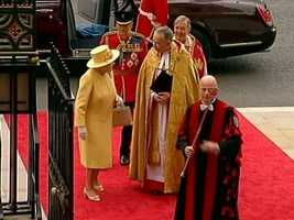 The queen addressing clergy as she arrives.