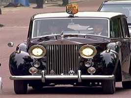Kate followed in an antique limousine.