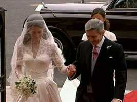 Kate entering the abbey on the hand of her father, Michael.