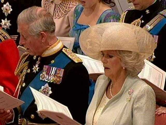 Charles singing, with Camilla by his side.
