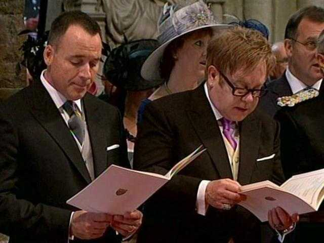 Among the invited guests, Sir Elton John, right, who sang at Princess Diana's funeral.