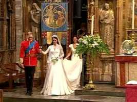 After the ceremony, William leading his bride out of the abbey.