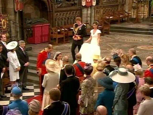 On their way out, Phillip and his bride stopped and she curtsied before Queen Elizabeth and Phillip.