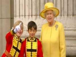 Queen Elizabeth looking on.