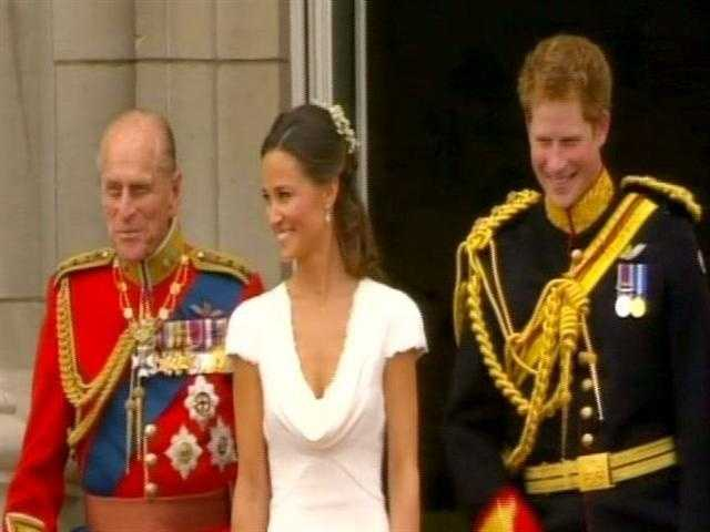 Phillip, Pippa and Harry on the balcony.