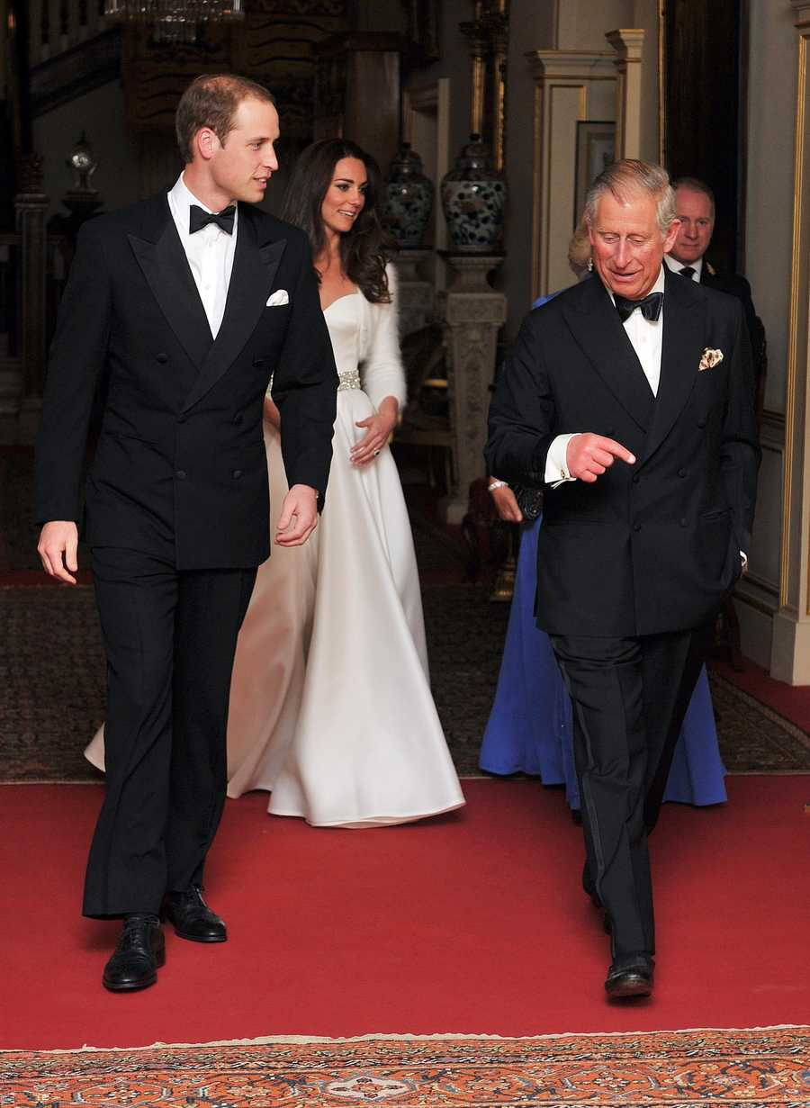 After a change out of their ceremony clothes, Britain's Prince William, Catherine, Duchess of Cambridge, Camilla, Duchess of Cornwall  and Prince Charles leave Clarence House to travel to Buckingham Palace for the evening celebrations.