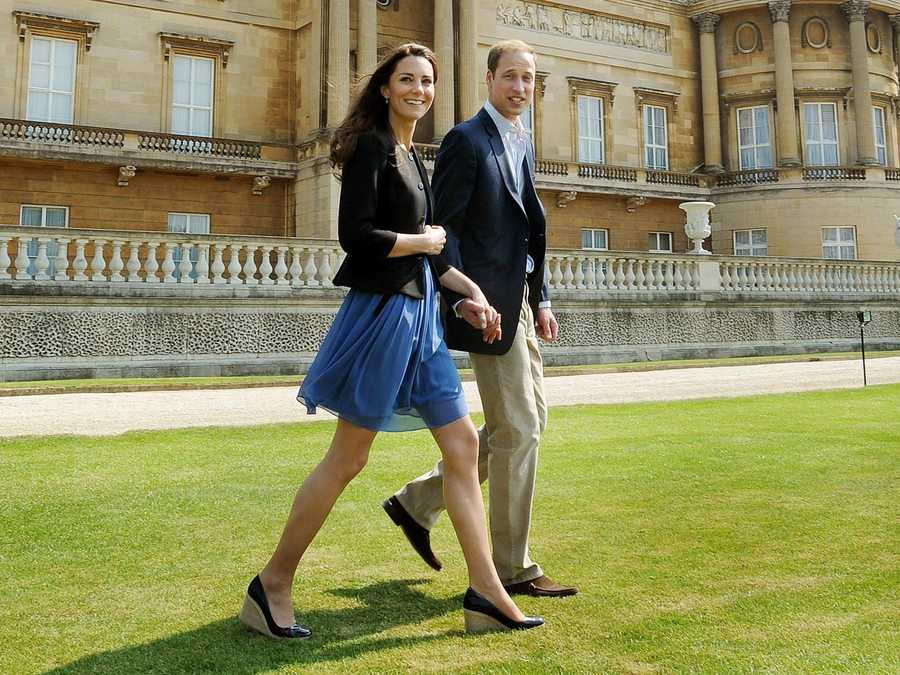 Britain's Prince William and Catherine, Duchess of Cambridge, walk together in Buckingham Palace the day after their wedding.