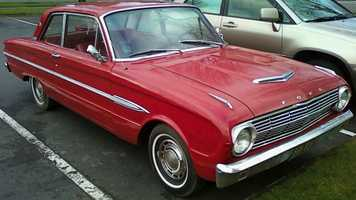 "Randy's first car was a red 1963 Ford Falcon coupe.  ""Hardly as elegant as the bird, but it was a second car in our family which I was allowed to use.   And, in a blue collar home without a lot of affluence, it was sweet to me!"""