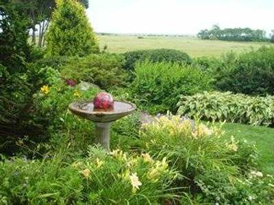 """and """"gardening to the extreme."""" This is a picture of Randy's garden at his former home in Kittery Point, Maine."""