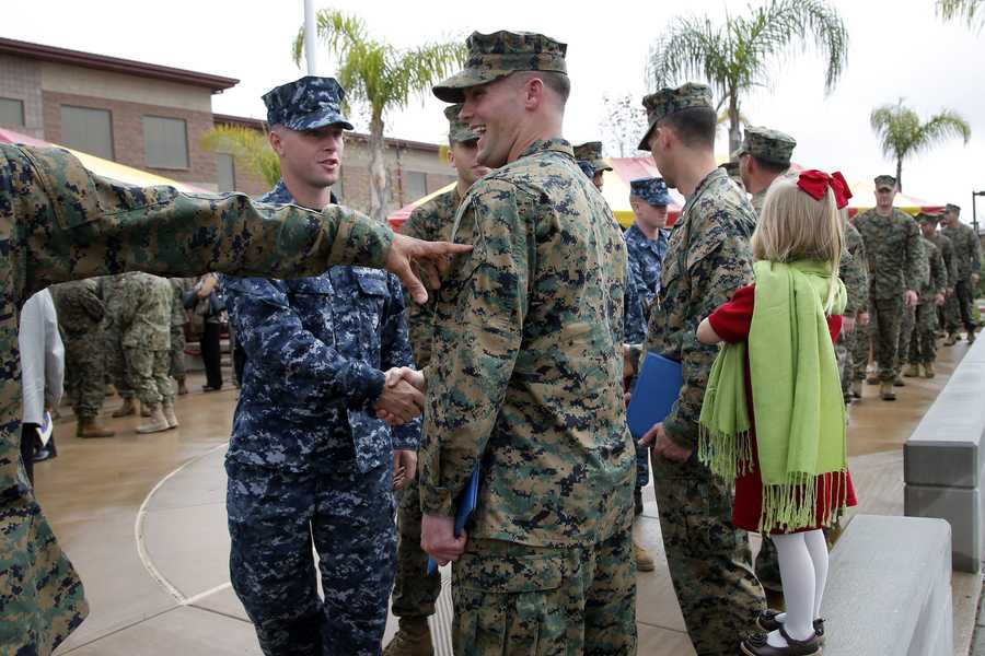 U.S. Marine Sgt. William Soutra Jr., center, is congratulated by fellow service members after receiving the Navy Cross during a ceremony held at Camp Pendleton, Calif., Monday, Dec. 3, 2012. Soutra was awarded the medal for his heroism while serving in Afghanistan.
