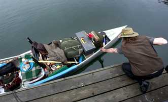 He's aboard a 14-foot, 40-year-old canoe.
