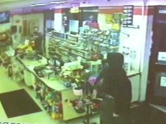 A store clerk fights back with a baseball bat after a robber storms the store demanding money at 4 a.m. The robber and an accomplice were arrested a short time later.