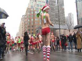 Hundreds of people stripped down to hardly anything on Saturday for the 12th annual Santa Speedo Run in Boston.