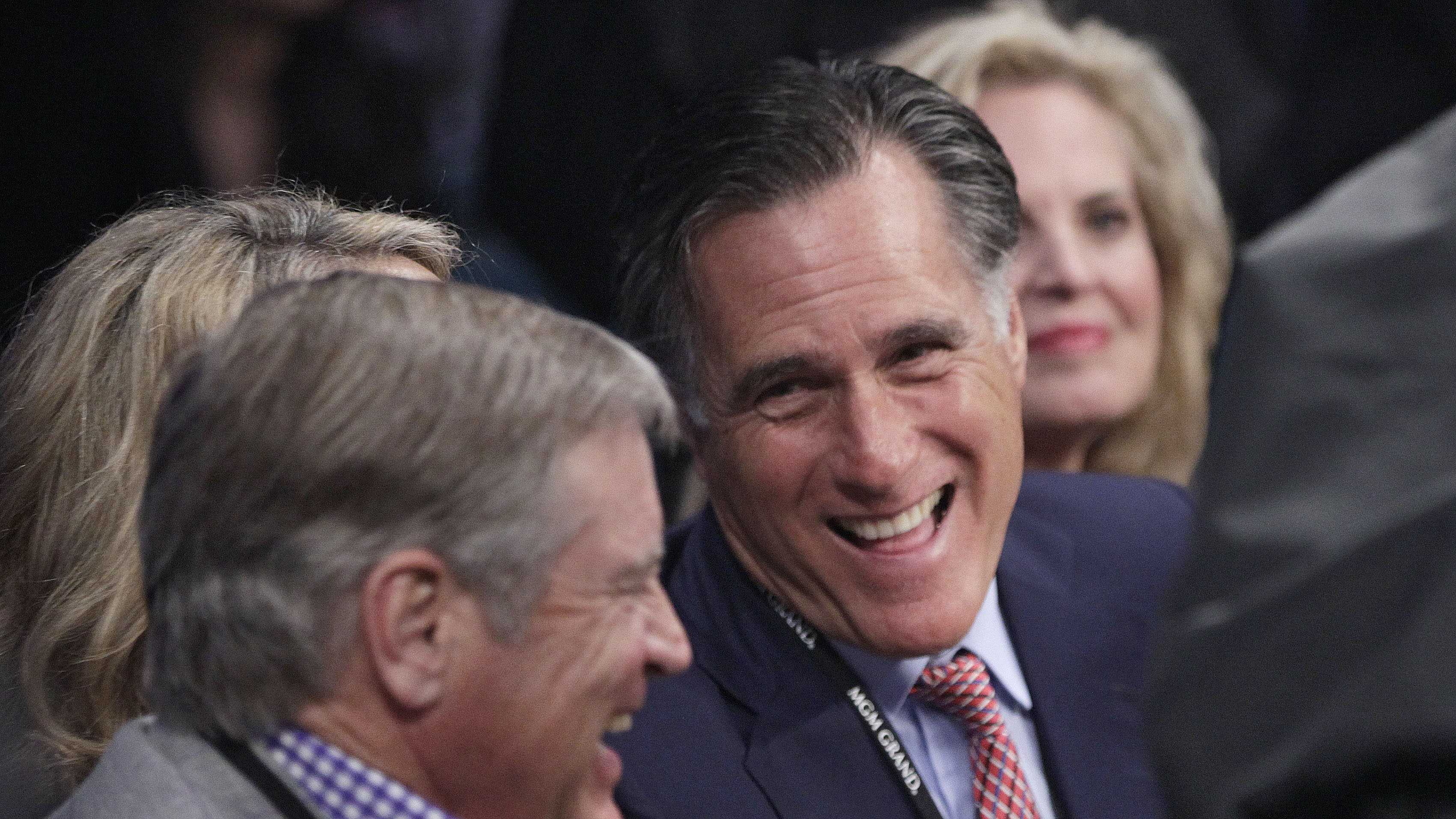Former Republican presidential candidate Mitt Romney, center, joined by wife Ann, right, talks with an unidentified spectator at ringside prior to a welterweight fight between Juan Manuel Marquez and Manny Pacquiao title fight in Las Vegas.
