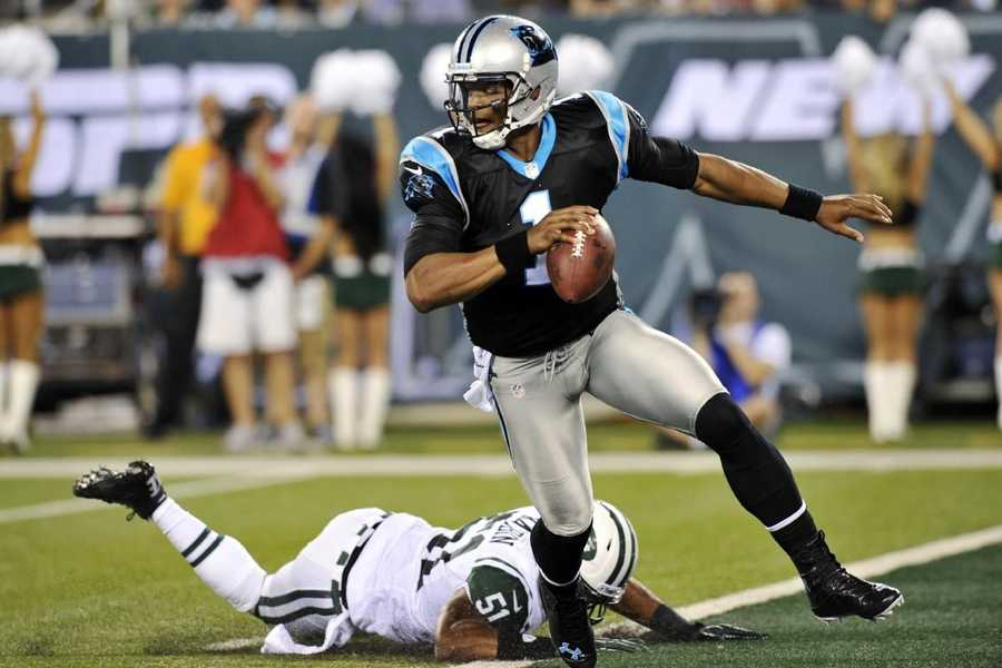 "30) Carolina Panthers - The Panthers are one of the 'newest' teams in the NFL, but their jerseys have had many tweaks in their less than 20 years of existence. Uni Watch says: ""The tapered stripes on the pants and helmet looked silly back then and are hopelessly dated now, and the shoulder loops on the jersey look too crimped when rendered with today's skin-tight tailoring cuts."""