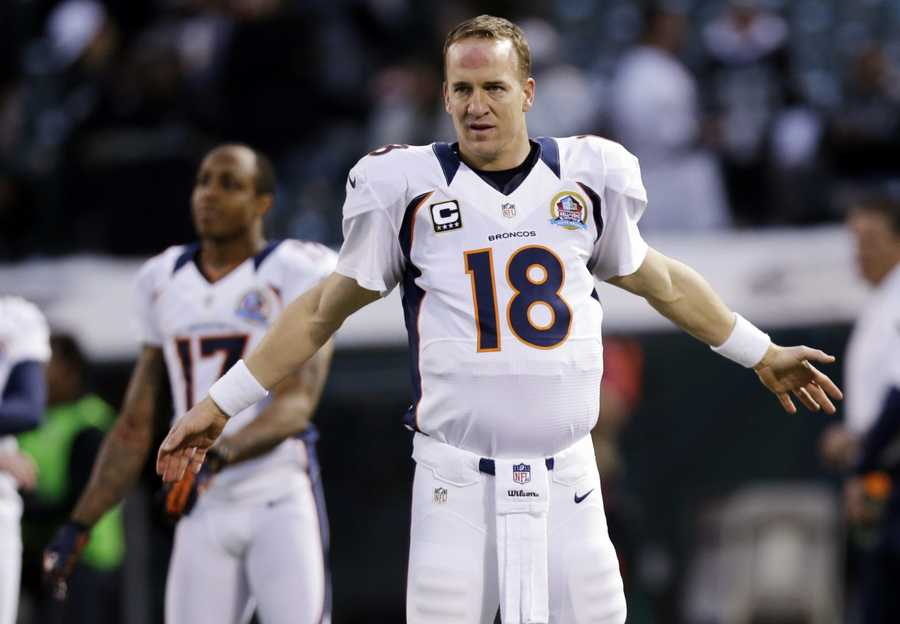 24) Denver Broncos - Uni Watch isn't a fan of the side panels that extend toward the player's shoulders.