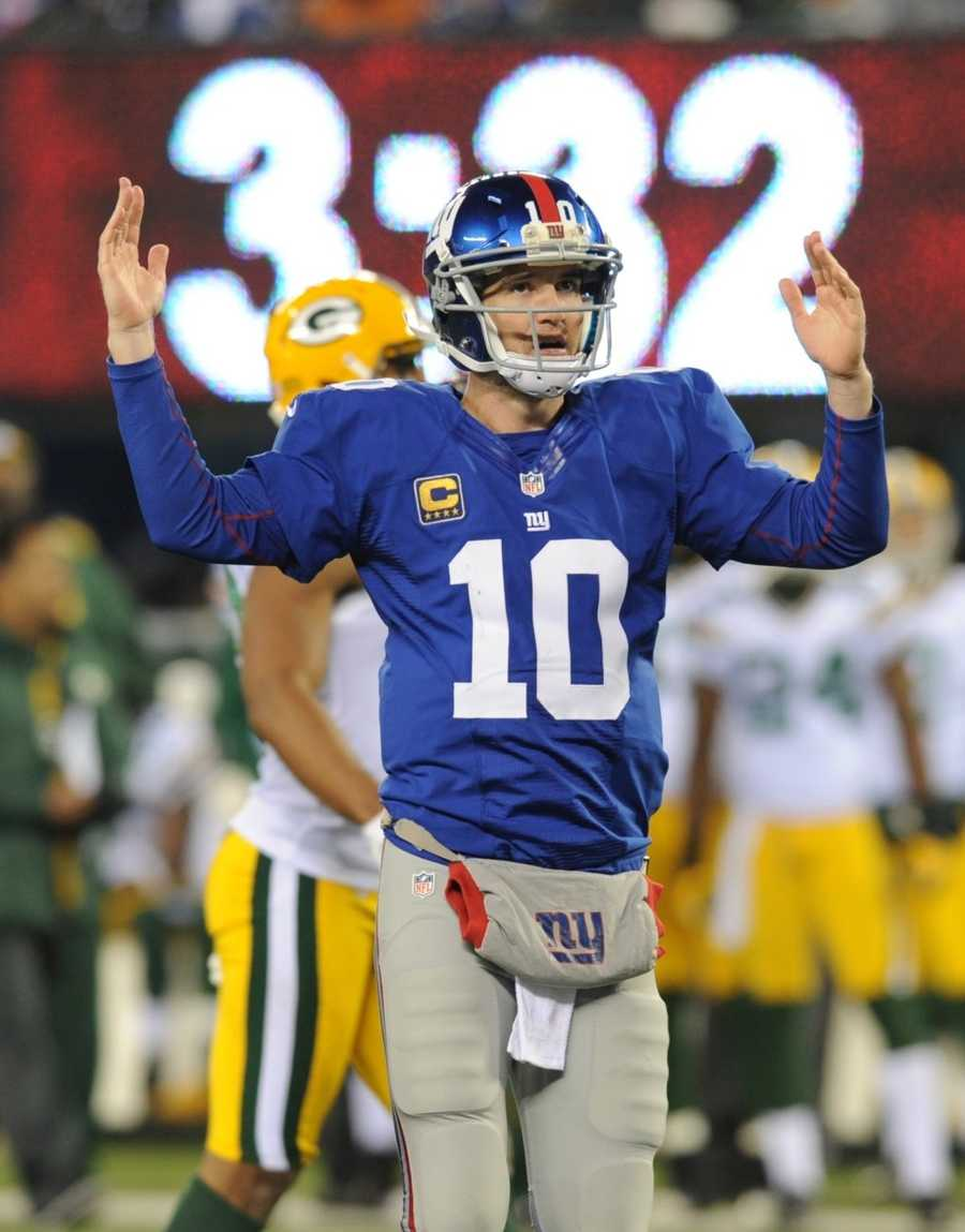 """18) New York Giants - Their nickname is """"Big Blue"""" - and Patriots fans know and hate them. Eli Manning is modeling off their home jersey, which Uni Watch says looks 'decent' - but questions the grey pants."""