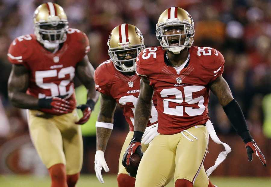 8) San Francisco 49ers - One of the classic looks of the NFL. But Uni Watch questions - what's up with the half-stripes on the shoulders of the uniform?