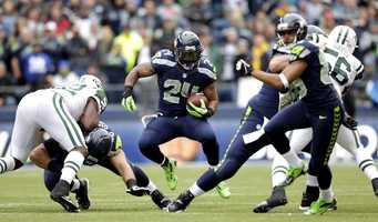 """27) Seattle Seahawks - This team has had what seems like jersey changes every season.  With Nike taking over the design of all NFL jerseys, the team elected to make some big changes in the off-season.  The result is what you see here: what Uni Watch calls an outfit that looks more like """"superheroes wearing costumes vs. athletes wearing uniforms."""""""