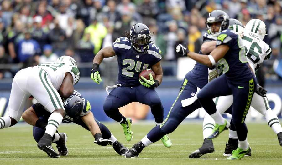"27) Seattle Seahawks - This team has had what seems like jersey changes every season.  With Nike taking over the design of all NFL jerseys, the team elected to make some big changes in the off-season.  The result is what you see here: what Uni Watch calls an outfit that looks more like ""superheroes wearing costumes vs. athletes wearing uniforms."""