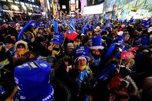 Crowds bundled up for a chilly 2009 start. The average temperature at midnight in New York City since the ball dropping tradition began in 1907 is 33.7 °F